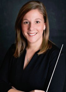 "Dr. Debra L. Traficante, Associate Director of Bands Director of ""The Marching Owls"""